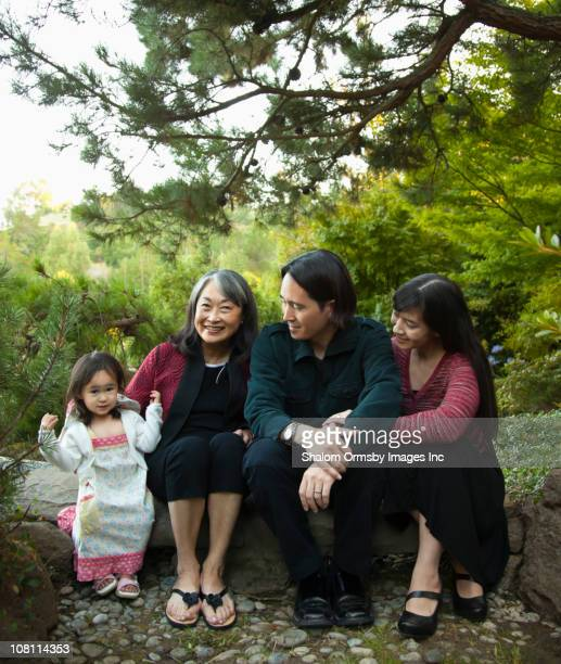 Multigenerational family sitting in garden