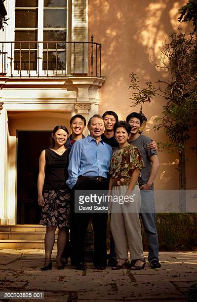 Multi-generational family smiling, portrait