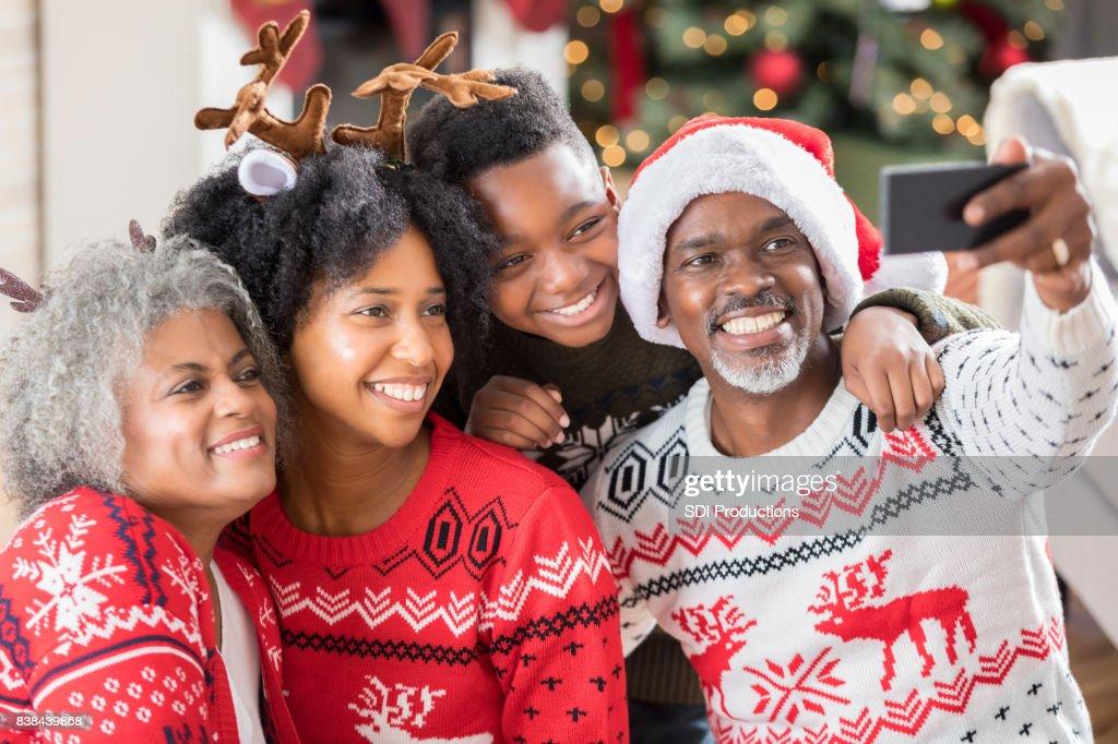 Multi-generational family takes selfie on Christmas morning : Stock Photo