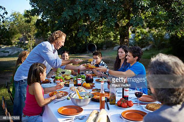multigenerational family together at dinner - klaus vedfelt mallorca stock pictures, royalty-free photos & images