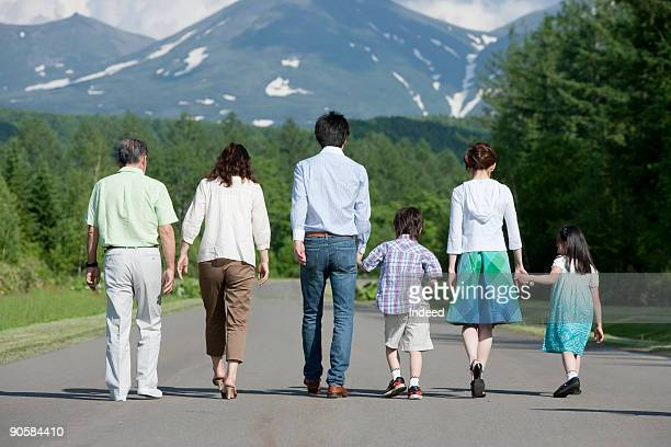 multi-generational family walking on road