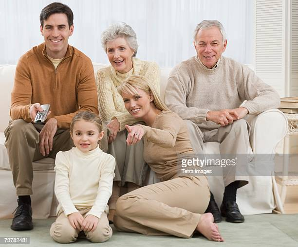Multi-generational family watching television