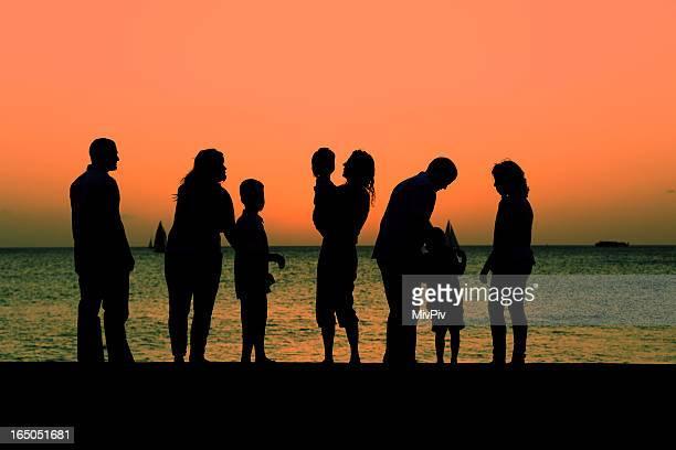 Multigenerational family watching the sunset