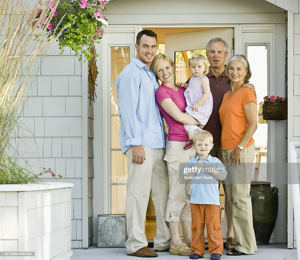 Multigenerational family with baby girl (9-12 months) and son (2-3 years) on porch : Foto stock