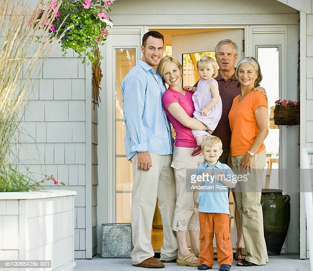 multigenerational family with baby girl (9-12 months) and son (2-3 years) on porch - 30 39 years imagens e fotografias de stock
