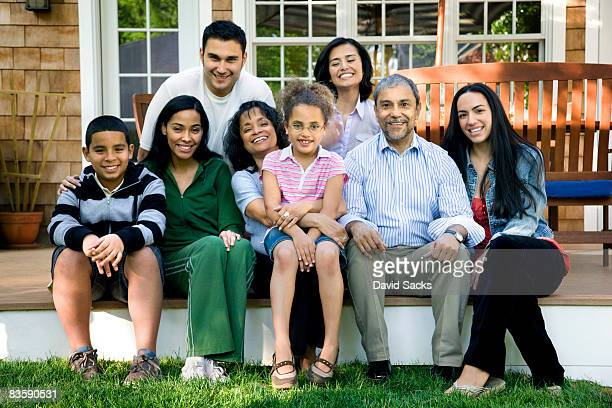 multigenerational hispanic family on porch - lap body area stock photos and pictures