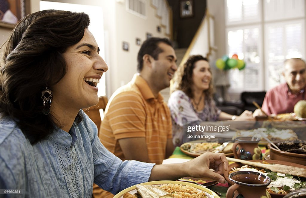 Multigenerational Mexican Family Celebrates Dinner Stock Photo