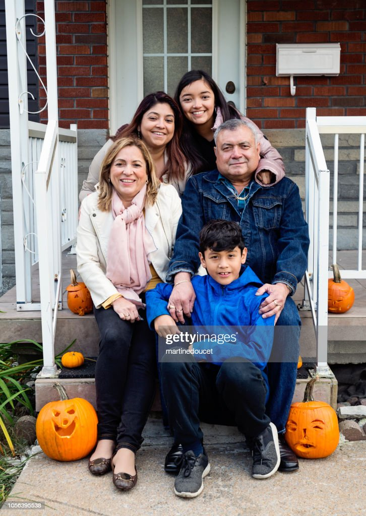 Multi-generations Latin American family portrait outdoors. : Stock Photo