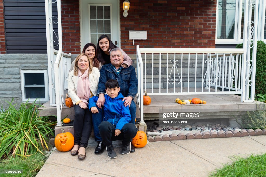 Multi-generations Latin American family portrait outdoors. : Stock Photo