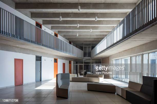 Multi-level interior of dormitory with common space and atrium. Thapar University, Patiala, India. Architect: McCullough Mulvin Architects, 2018.