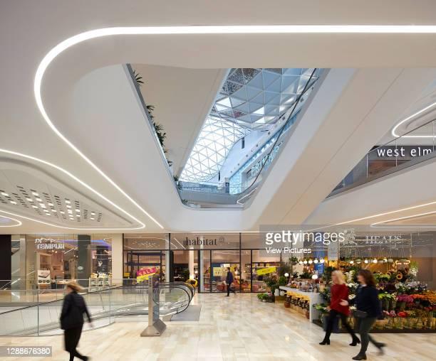 Multi-level shopping street under skylight. Westfield White City, London, United Kingdom. Architect: UNStudio, 2018.