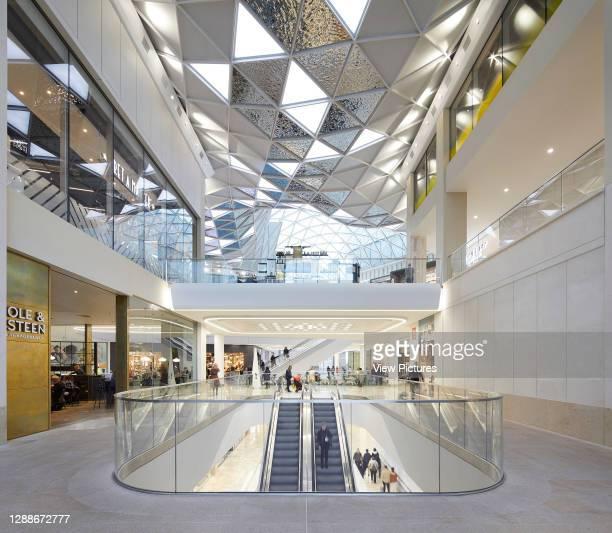 Multi-level shopping streets beneath skylight. Westfield White City, London, United Kingdom. Architect: UNStudio, 2018.