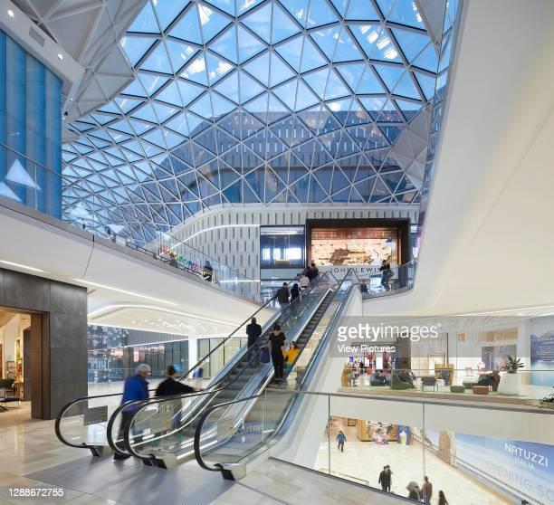 Multi-level shopping streets under skylight roof. Westfield White City, London, United Kingdom. Architect: UNStudio, 2018.