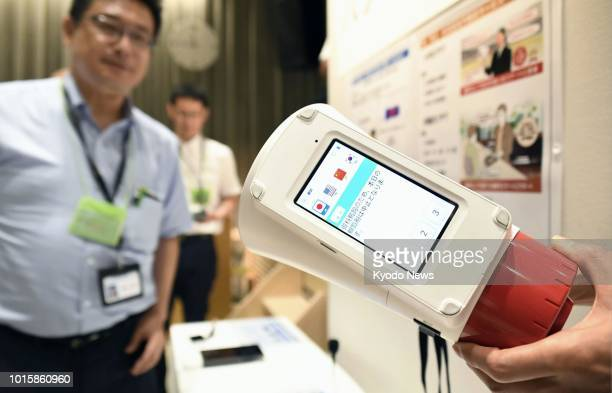 A multilingual voice translation device is exhibited during a demonstration event in Gifu city on Aug 12 2018 The eightlanguage translation device...