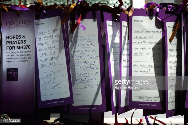 Multilingual well wish cards dedicated to the flight MH370 is seen at a mall March 17 2014 in Kuala Lumpur Malaysia The search area for Malaysia...
