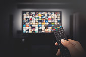 Multimedia video concept on TV set in dark room