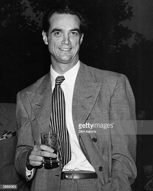 Multimillionaire businessman film producer and director Howard Hughes a spectator at Howard Hawks' EastWest croquet match Original Artwork A...