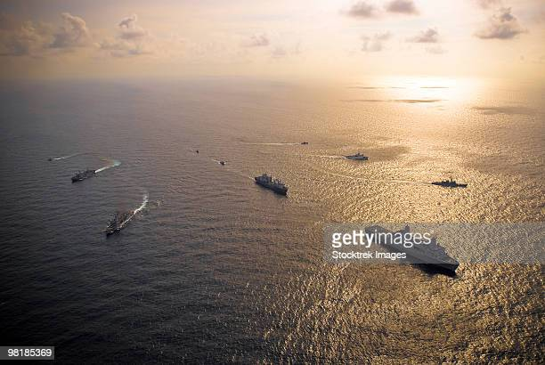a multi-national naval force navigates the waters of the caribbean sea. - battleship stock pictures, royalty-free photos & images
