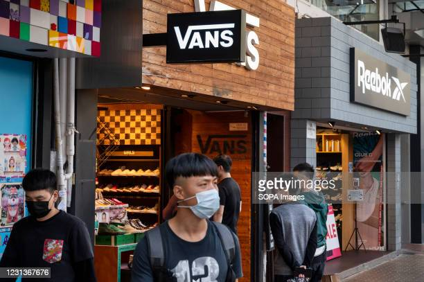 Multinational sports clothing brands Vans and Reebok stores and logos in Hong Kong.