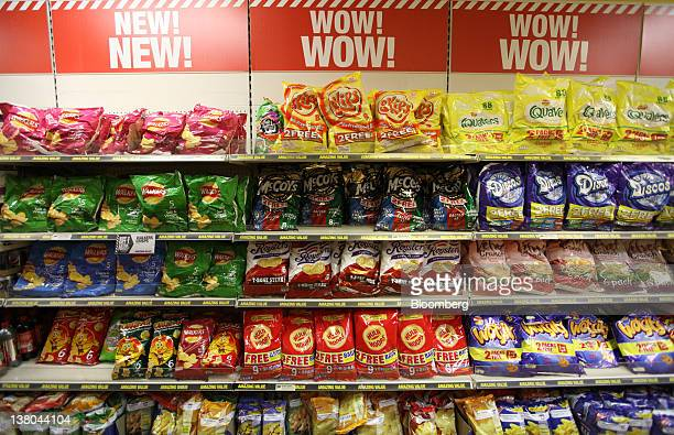 Multipack bags of crisps sit on display at a Poundland discount store in Croydon UK on Wednesday Feb 1 2012 Poundland Holdings Ltd operates houseware...
