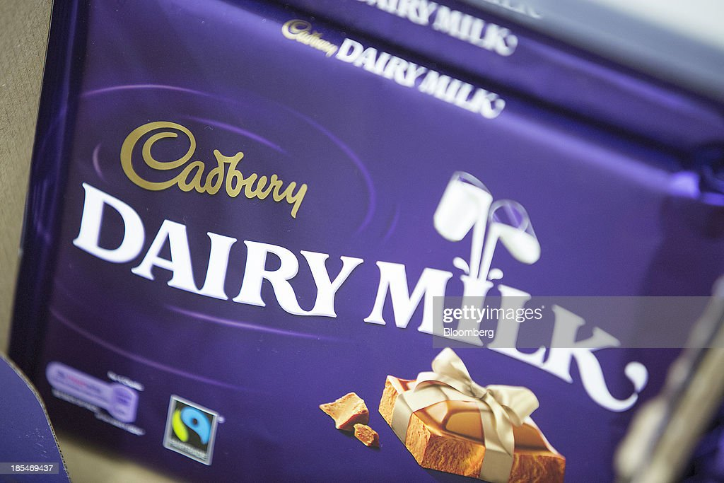 Multi-pack bars of Cadbury 'Dairy Milk' chocolate, manufactured by Kraft Foods Inc., sit displayed for sale inside an Asda supermarket, the U.K. retail arm of Wal-Mart Stores Inc., in Watford, U.K., on Thursday, Oct. 17, 2013. U.K. retail sales rose more than economists forecast in September as an increase in furniture demand led a rebound from a slump the previous month. Photographer: Simon Dawson/Bloomberg via Getty Images