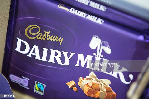 Multipack bars of Cadbury 'Dairy Milk' chocolate manufactured by Kraft Foods Inc sit displayed for sale inside an Asda supermarket the UK retail arm...