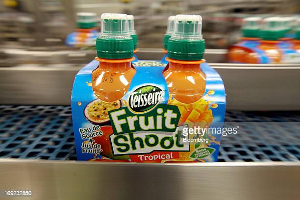 A multipack of Robinsons Fruit Shoot tropical drink produced by Britvic Plc moves along the production line at the company's factory in Norwich UK on...