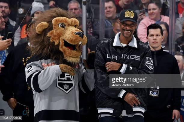 Multiplatinum artist actor philanthropist and entertainment icon Snoop Dogg jokes with Los Angeles Kings' mascot Bailey as he waits for a ceremonial...