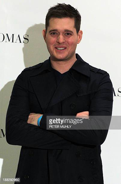 Multiplatinum Canadian singer Michael Buble poses in the Thomas Brown store in Dublin on November 18 2011 Buble is in Dublin promoting his new...
