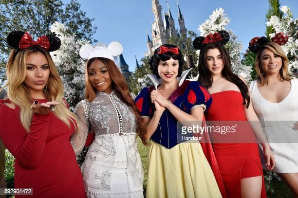 Multiplatinumselling group Fifth Harmony poses with Snow White after singing Can You See at Magic Kingdom Park in Lake Buena Vista Fla November 7...