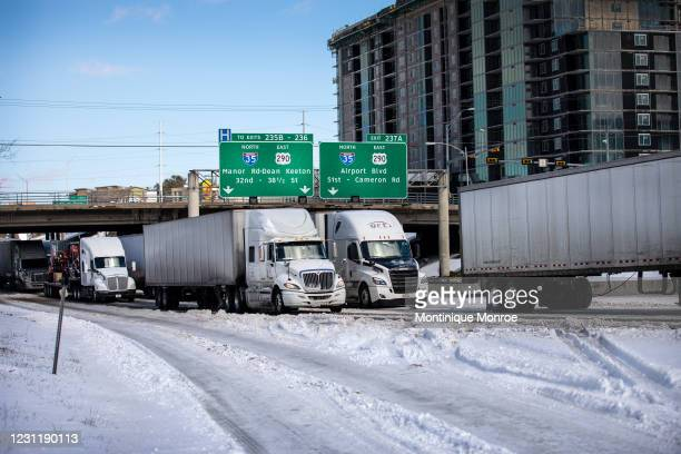 Multiple 18-wheelers wait in traffic on I-35 Southbound on February 15, 2021 in Austin, Texas. Winter storm Uri has brought historic cold weather to...