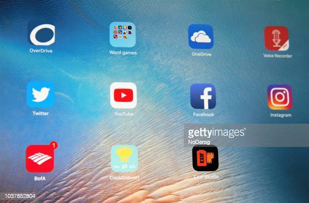 multiple apps on an ipad screen including various social media apps - school icon stock photos and pictures