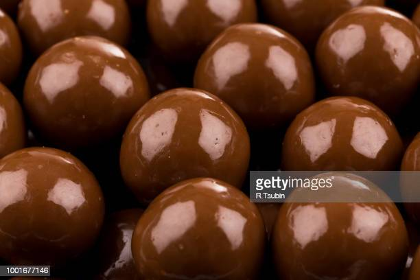 Multiple chocolate ball candies composition, isolated over the white background