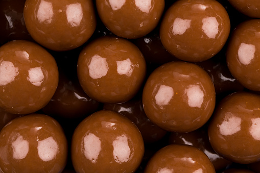 Multiple chocolate ball candies composition, isolated over the white background - gettyimageskorea