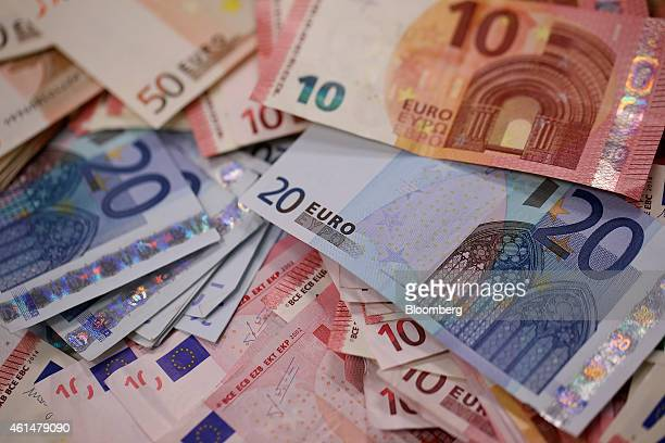 Multiple denomination euro banknotes are arranged for a photograph inside a Travelex store operated by Travelex Holdings Ltd in London UK on Monday...