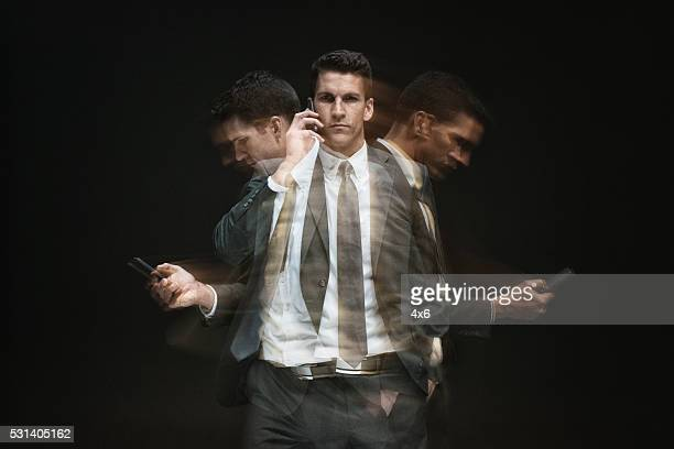 multiple exposure - businessman using phone - multi tasking stock pictures, royalty-free photos & images