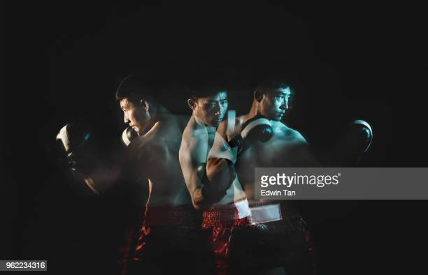 multiple exposure for asian chinese male with boxing gloves - boxing sport stock pictures, royalty-free photos & images