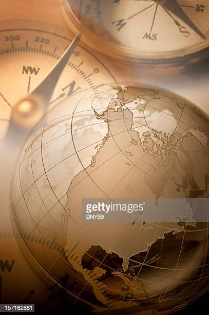 Multiple exposure globe and two compasses
