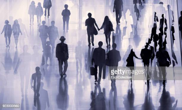 Multiple exposure image of people walking in a city
