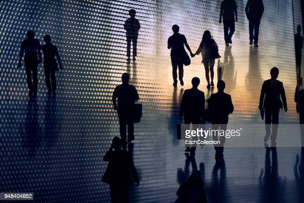 Multiple exposure image of people walking in city