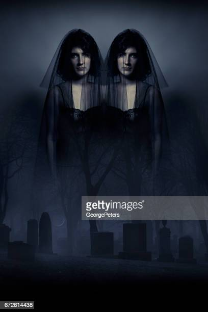 multiple exposure image of spooky identical twins haunting a foggy cemetery - conjoined twin stock photos and pictures