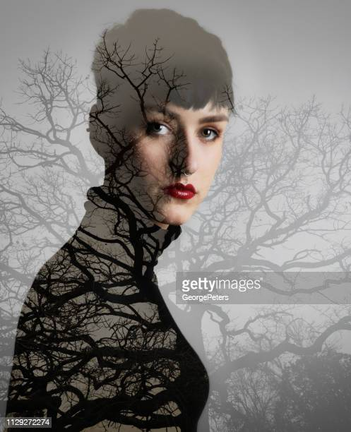multiple exposure image of woman morphing into trees - vulnerability stock pictures, royalty-free photos & images