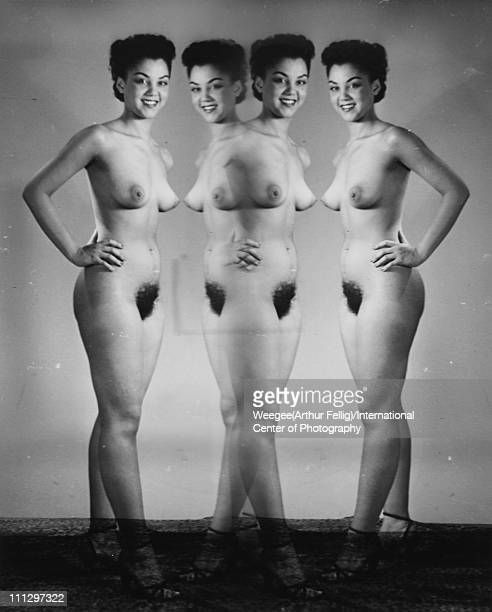 Multiple exposure 'mirror' view of a nude woman in high heels as she poses with her hand on her hip mid 20th century Photo by Weegee/International...