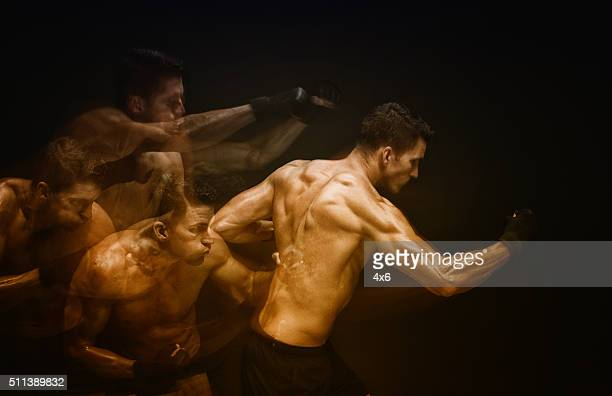 multiple exposure - muscular man in combat pose - mixed martial arts stockfoto's en -beelden
