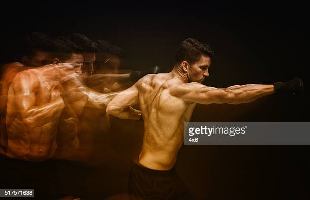 multiple exposure - muscular man punching - mixed martial arts stock pictures, royalty-free photos & images