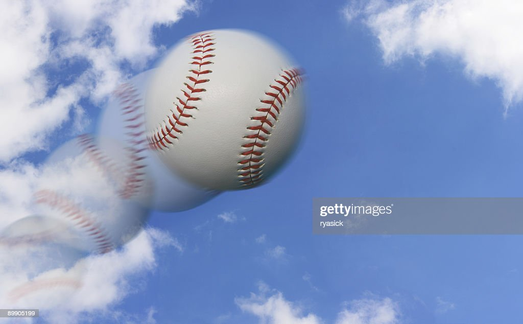 Multiple Exposure of a Baseball Flying Through the Sky : Stock Photo