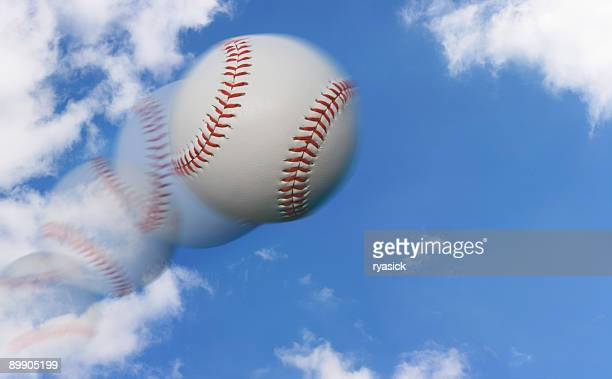 multiple exposure of a baseball flying through the sky - baseball trajectory stock photos and pictures