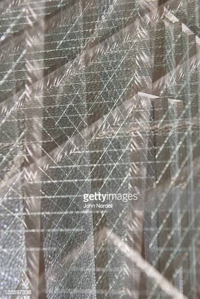 Multiple exposure of a glass window and wire mesh
