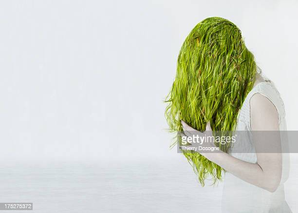 multiple exposure of a woman with green vegetation - green hair stock pictures, royalty-free photos & images
