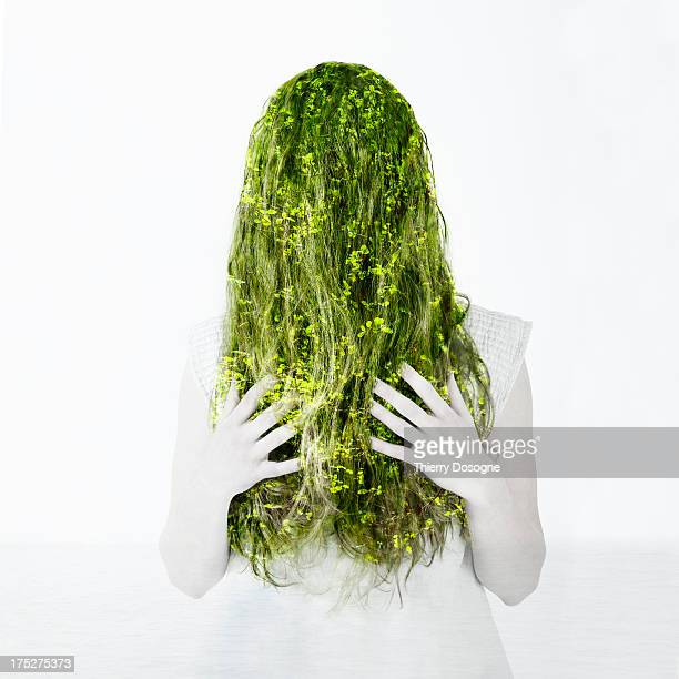 Multiple exposure of a woman with green vegetation